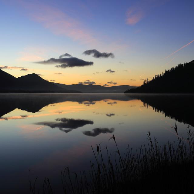 """Sunrise over Bassenthwaite lake, Keswick town, Lake District National Park,..."" stock image"