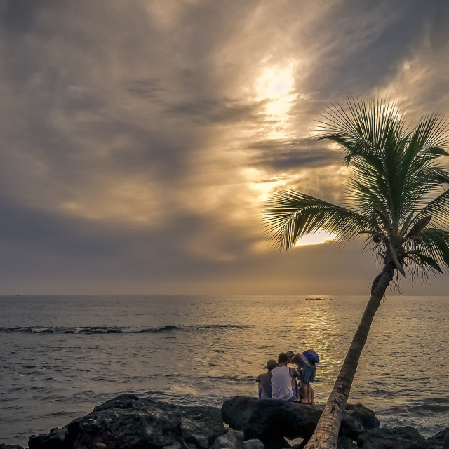 """""""On the Rocks By the Ocean Watching Sunset"""" stock image"""