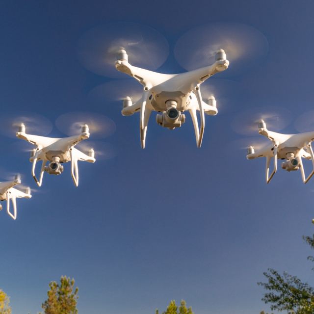 """Formation of Drones Swarm in the Blue Sky"" stock image"