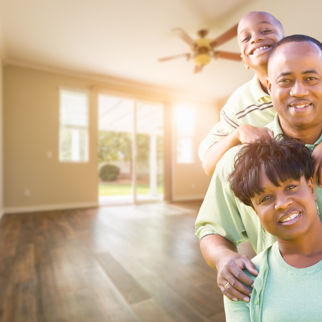 """Happy African American Young Family In Empty Room of House"" stock image"