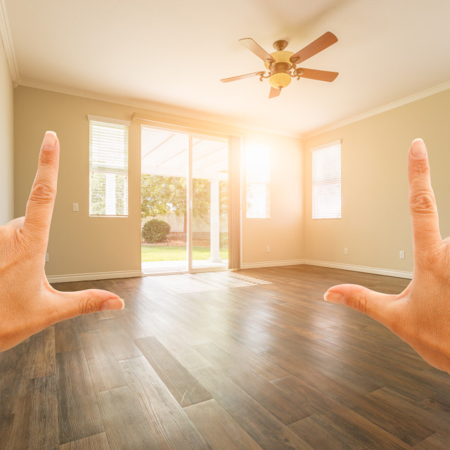 """Female Hands Framing Empty Room of House"" stock image"