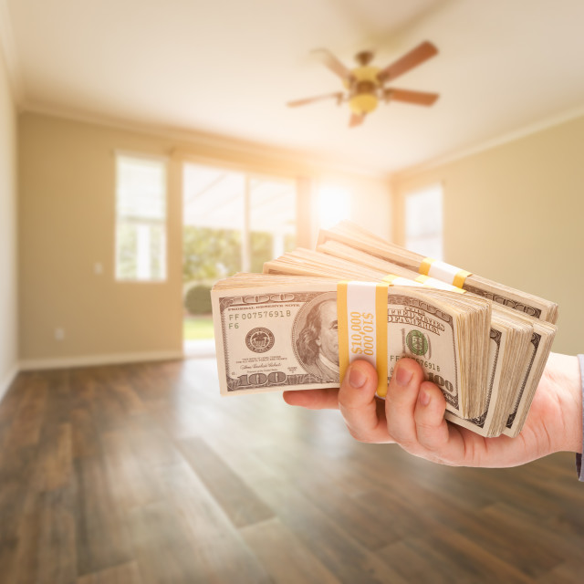 """Handing Over Thousands of Dollars In Empty Room of House"" stock image"