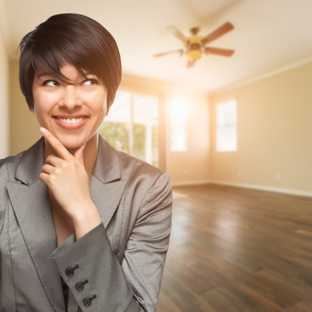 """Mixed Race Young Adult Woman In Empty Room of House"" stock image"
