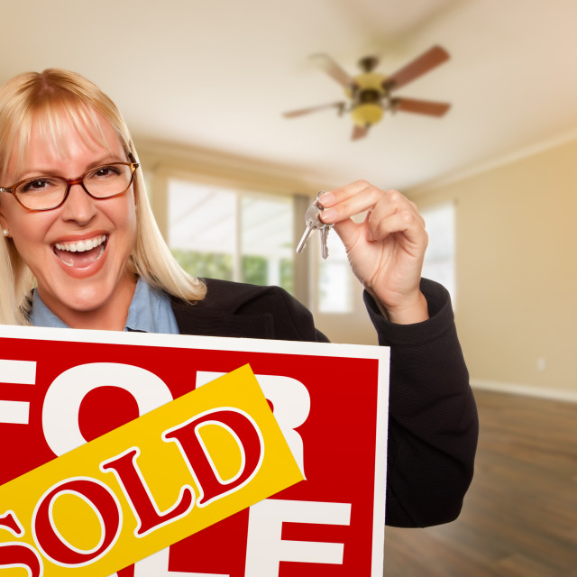 """Attractive Young Woman with New Keys and Sold Real Estate Sign In Empty Room..."" stock image"