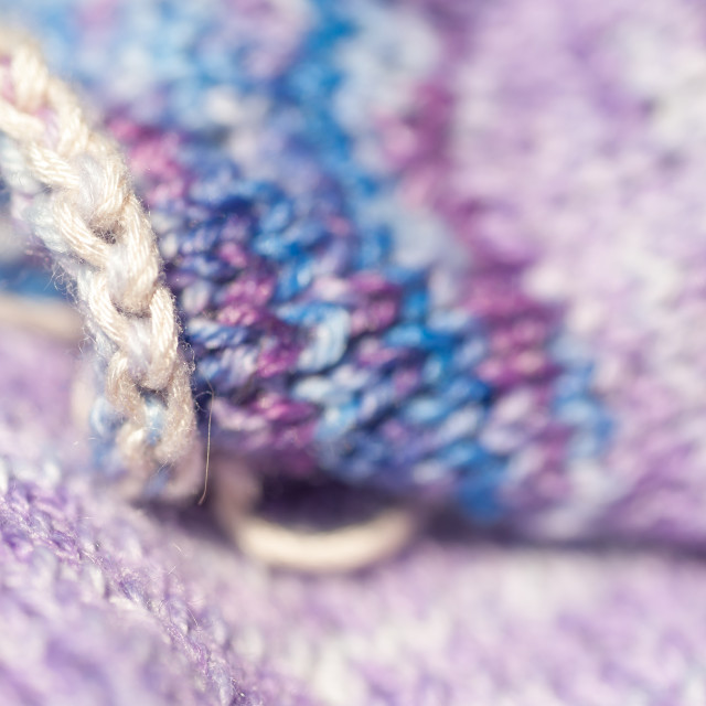 """Abstract of seamless knitted patterns in pastel colors macro with selective focus on creamy white edge. Concept: Knitting Passion and Color Impact"" stock image"