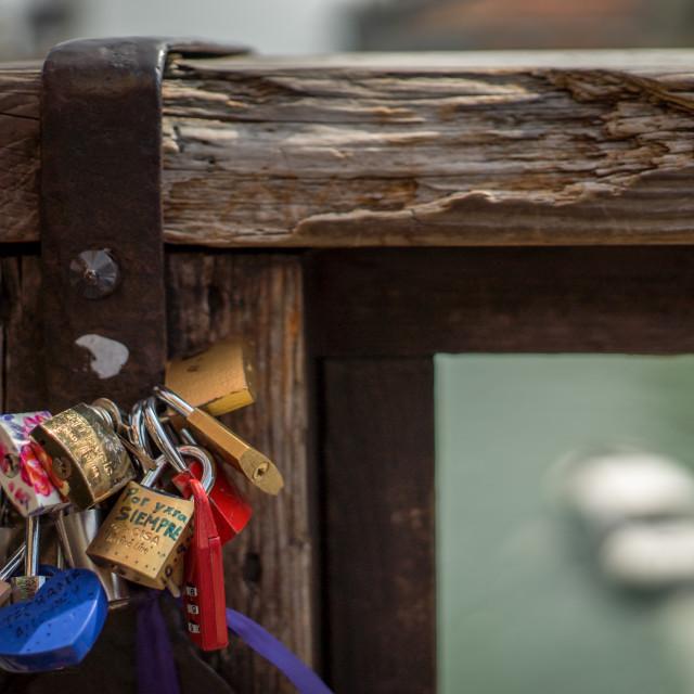 """Locks on a bridge above the Venetian Grand Canal"" stock image"