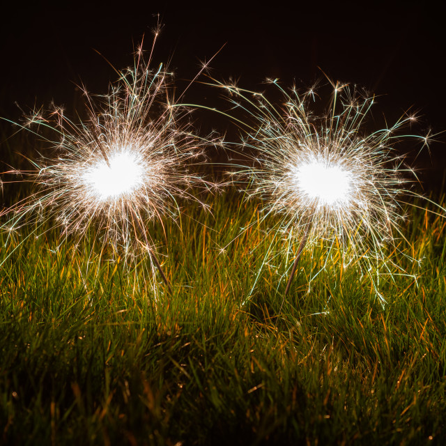 """Sparklers in the grass"" stock image"