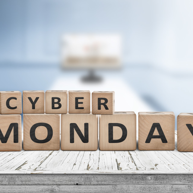 """""""Cyber monday sign on a wooden desk with a monitor"""" stock image"""