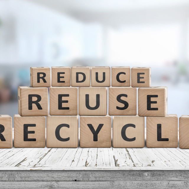 """Reduce, reuse and recycle sing on a wooden desk"" stock image"