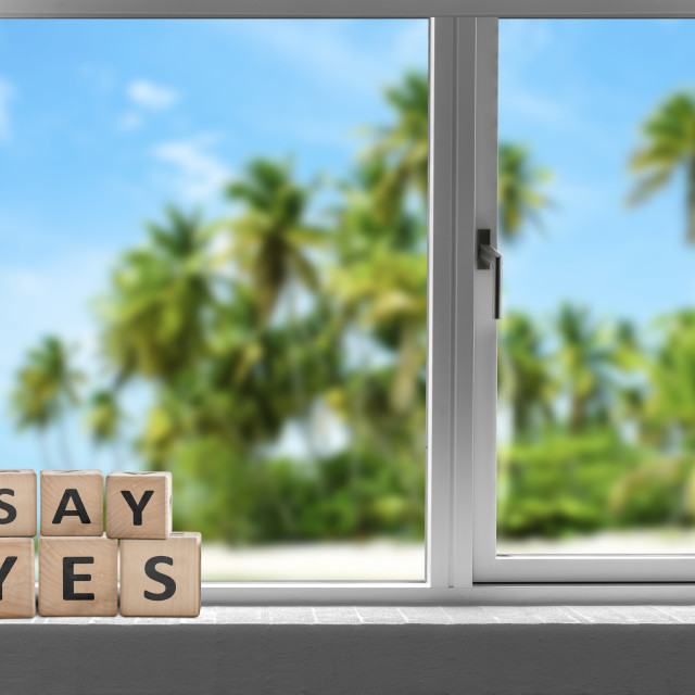 """Say yes sign in a window on a tropical beach"" stock image"