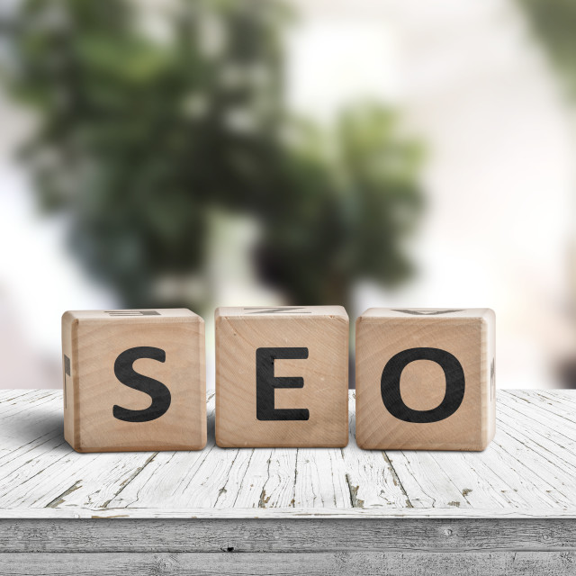 """SEO word sign on a table in a bright room"" stock image"