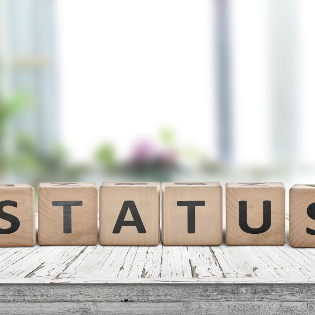 """Status sign made of wood on a table"" stock image"