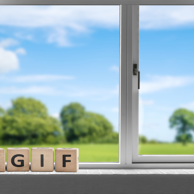 """TGIF weekend sign in a white window"" stock image"