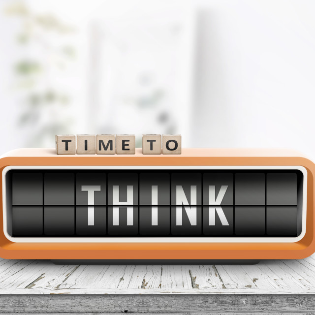 """Time to think text on an old alarm clock"" stock image"