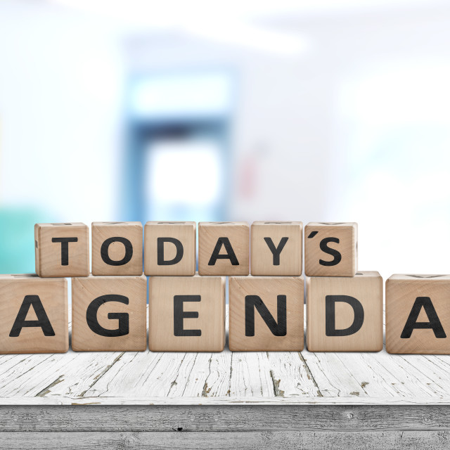 """Today's agenda sign on a wooden desk"" stock image"