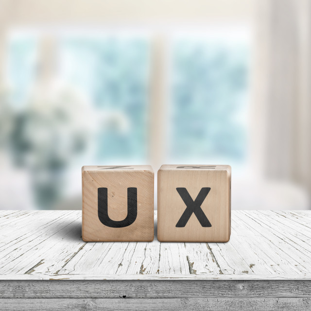 """UX development sign on a table in a bright room"" stock image"
