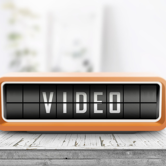 """Video message on a retro alarm clock"" stock image"
