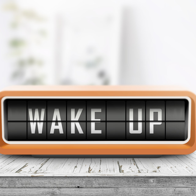 """Wake up alarm clock on a table in a bright room"" stock image"