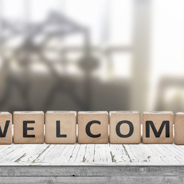 """Welcome sign on a table in a lobby"" stock image"