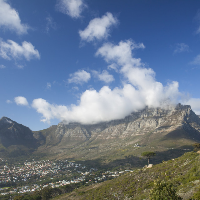 """""""Clouds spilling over Table Mountain in Cape Town."""" stock image"""