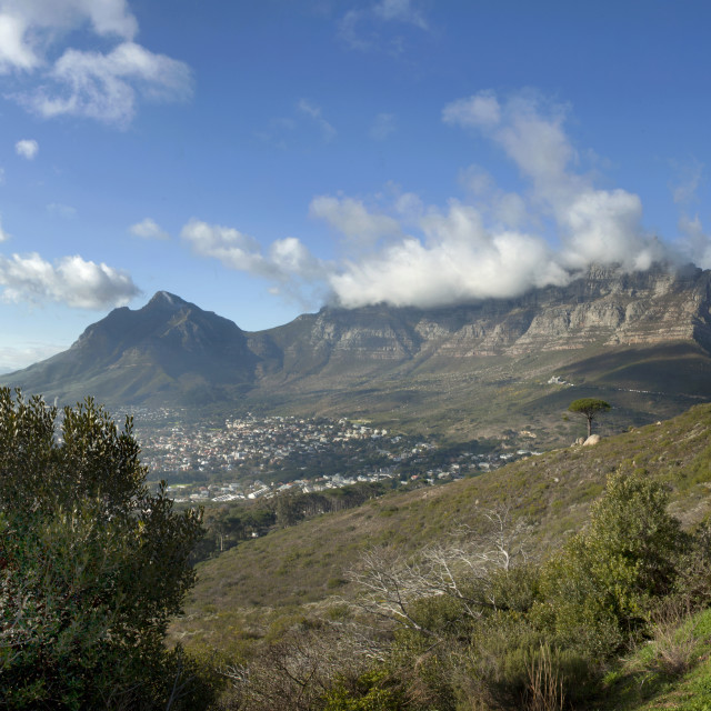 """Clouds spilling over Table Mountain in Cape Town."" stock image"