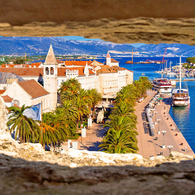 """""""Town of Trogir waterfront and landmarks panoramic view through stone window"""" stock image"""