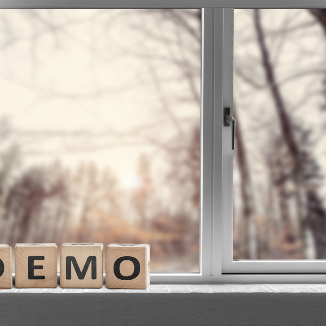 """Demo sign in a window with a view to a forest"" stock image"