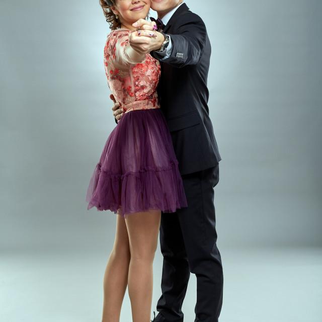 """Beautiful young couple dancing"" stock image"
