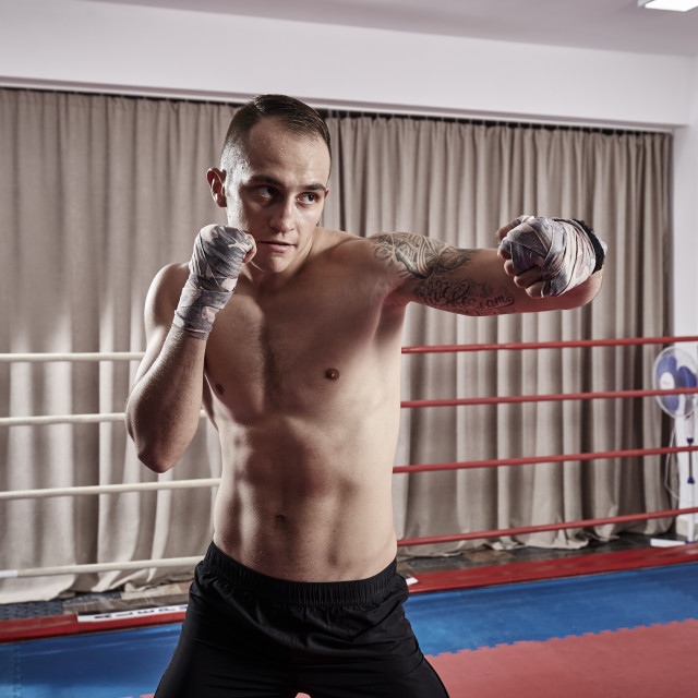 """""""Fighter doing shadow boxing"""" stock image"""