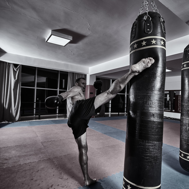 """""""Muay thai fighter working with heavy bag"""" stock image"""