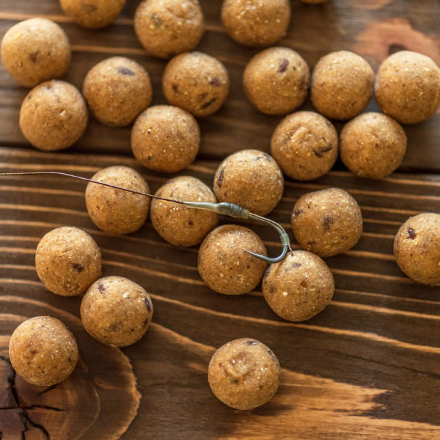 """""""Carp baits on a wooden background."""" stock image"""
