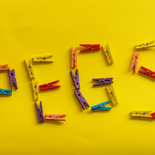 """""""Pegs on the yellow background with copy space."""" stock image"""