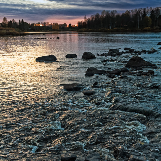 """""""Dramatic Sky Over The Rapids"""" stock image"""