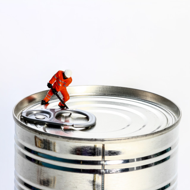 """""""Conceptual diorama image of miniature figure workman trying to open a tin can,"""" stock image"""
