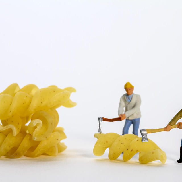 """Conceptual diorama image of miniature figures shaping fusilli pasta"" stock image"