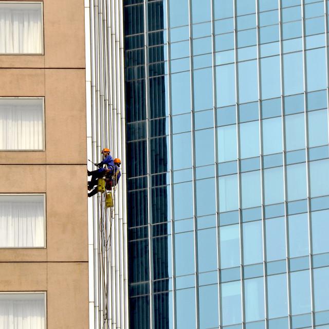"""Window cleaners Shanghai China"" stock image"