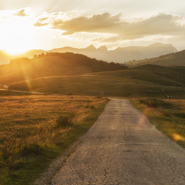 """""""Sunset on the road to Durmitor National Park in Montenegro."""" stock image"""