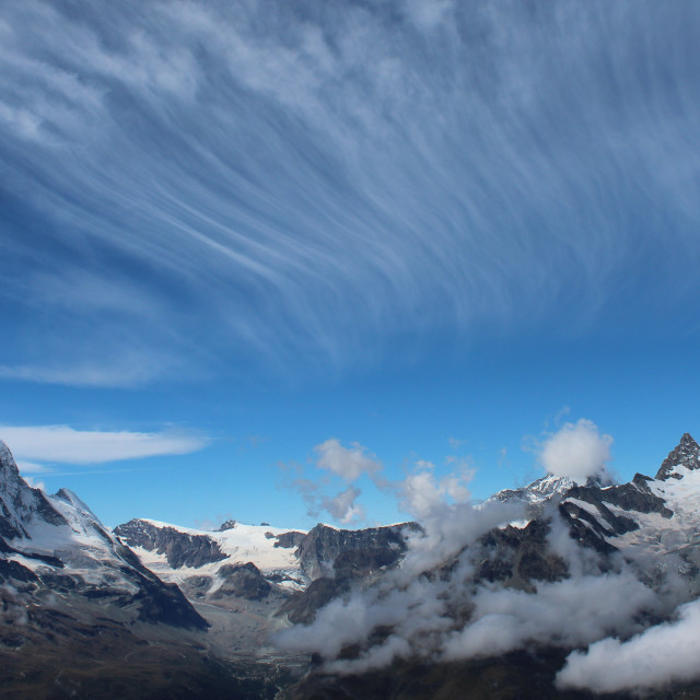 """""""Cirrus clouds over the alps"""" stock image"""