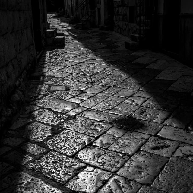 """Sun-lit stone narrow street in Italy"" stock image"