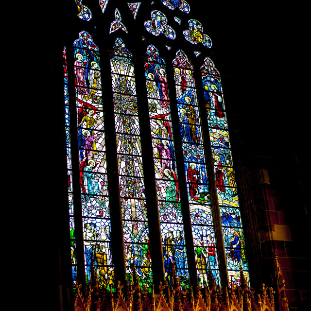 """""""BIRMINGHAM, UK - March 2018 Angle View of Stained Glass with Icons..."""" stock image"""