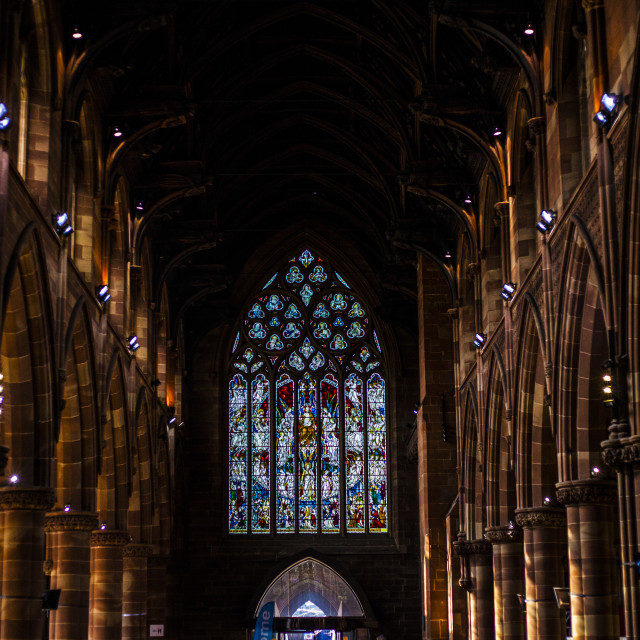 """""""BIRMINGHAM, UK - March 2018 Stained Glass Illuminating the Dark End Wall...."""" stock image"""