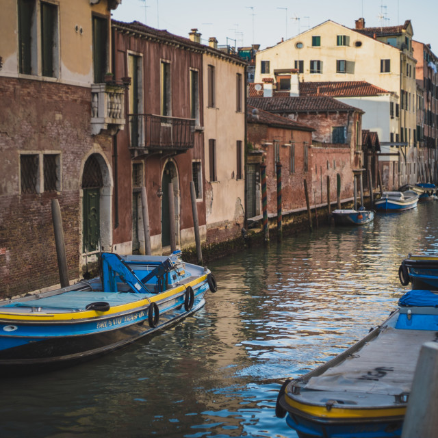 """""""Blue boats on the Venetian Canal"""" stock image"""