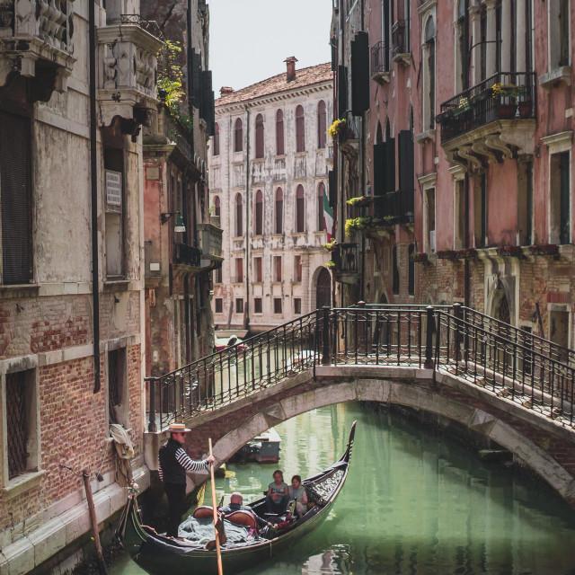 """""""Venetian Gondola Ride through a Canal"""" stock image"""