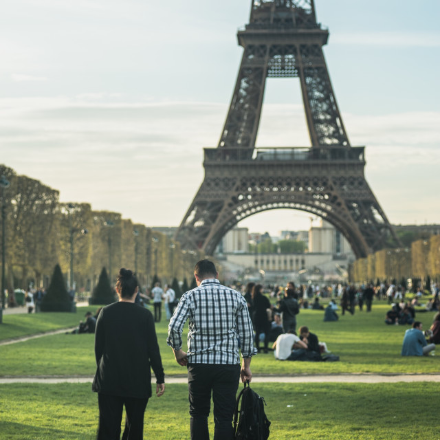 """""""Finding a picnic spot under the Eiffel Tower"""" stock image"""