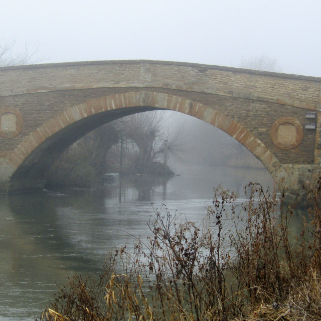 """Tadpole Bridge over Thames, Oxfordshire in fog"" stock image"