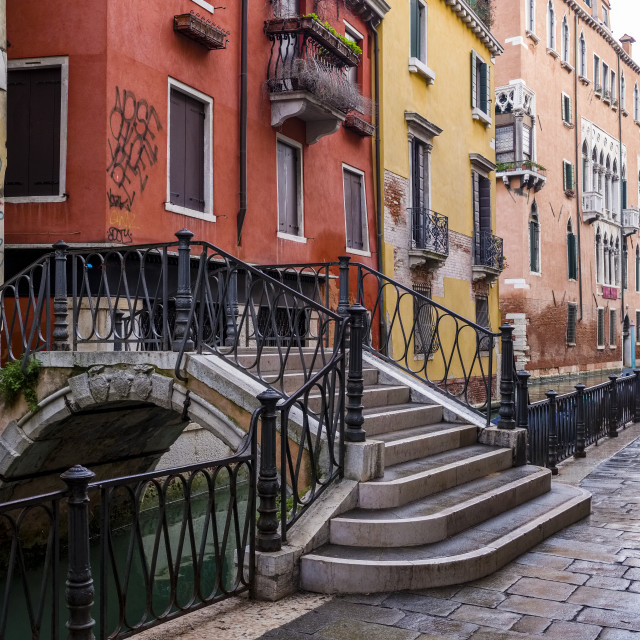 """""""Narrow streets leading through the ailing brick houses of the so-called 'Floating city', along water canals"""" stock image"""