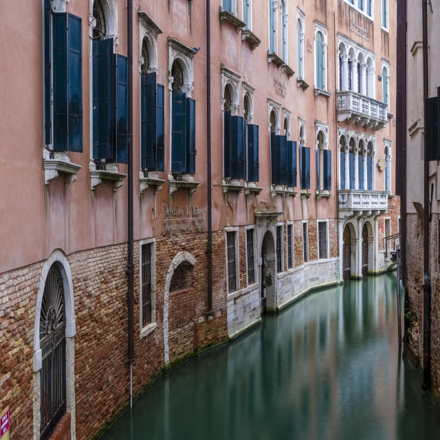 """""""Narrow water canals leading through the ailing brick houses of the so-called 'Floating city'"""" stock image"""