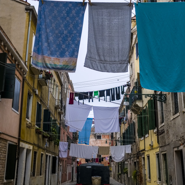 """""""Narrow streets leading through the ailing brick houses of the so-called 'Floating city', laundry is put up on washing lines"""" stock image"""