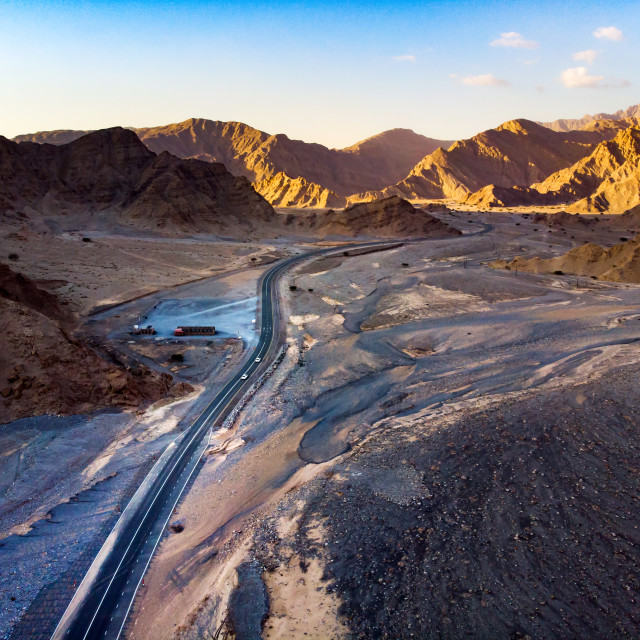 """""""Desert road surrounded by sandstones aerial view"""" stock image"""