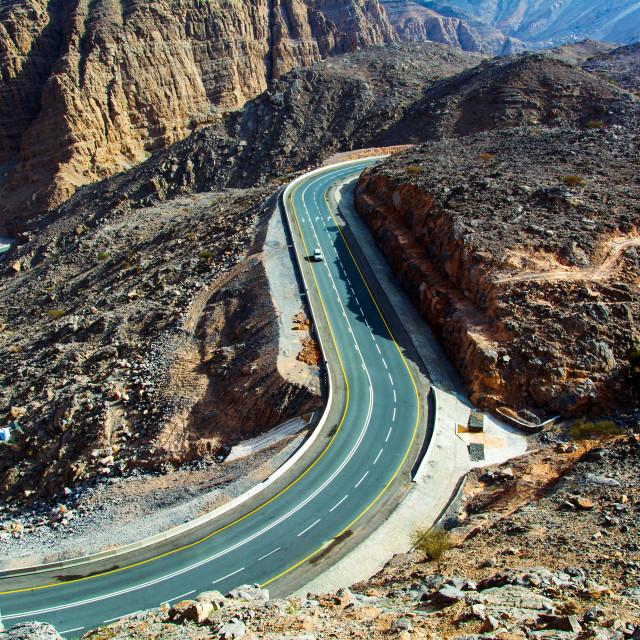 """Winding desert sandstone road of Jais mountain in UAE"" stock image"